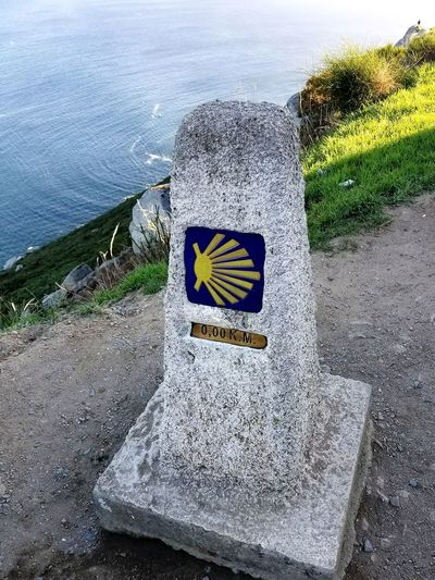 Communication Day Guidance Outdoors No People Water Nature Sea Road Sign Sky Mojon CaminodeSantiago Camino De Santiago Galicia, Spain Spaın Finisterre Fisterra Shell Km0