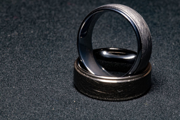 Close-up Ring Metal Jewelry Single Object Indoors  Wedding No People Black Color Two Objects Event Celebration Love Gray Life Events Focus On Foreground High Angle View Studio Shot Positive Emotion Silver Colored Steel Alloy Luxury