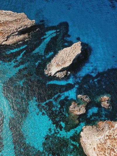 Comino Malta Droneshot Beachphotography Maltaphotography Ocean View Comino Island Malta Comino Blue Lagoon Malta Blue Lagoon Wonderful Place Droneshot DJI Mavic Pro Dronephotography Malta No People Blue Nature Water High Angle View Full Frame Backgrounds Land Sea Outdoors Beach