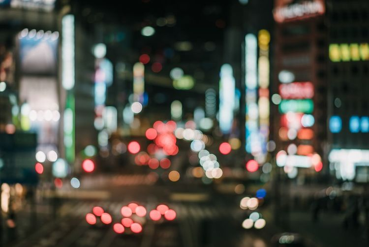 Illuminated City Night Defocused No People Multi Colored Street Built Structure Circle Geometric Shape Focus On Foreground Building Exterior Electric Light Lighting Equipment City Life Traffic Architecture Transportation Glowing Light