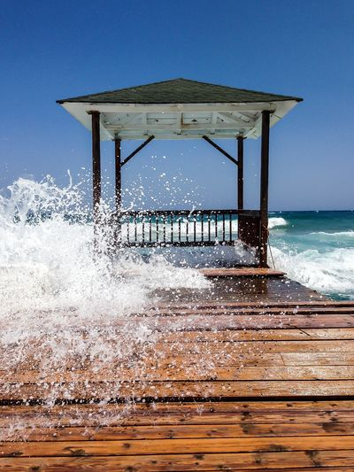 Water Sea Sky Motion Land Wave Beach Built Structure Architecture Nature Splashing Day Aquatic Sport Sport Surfing Pier Wood - Material Horizon Over Water Outdoors Power In Nature