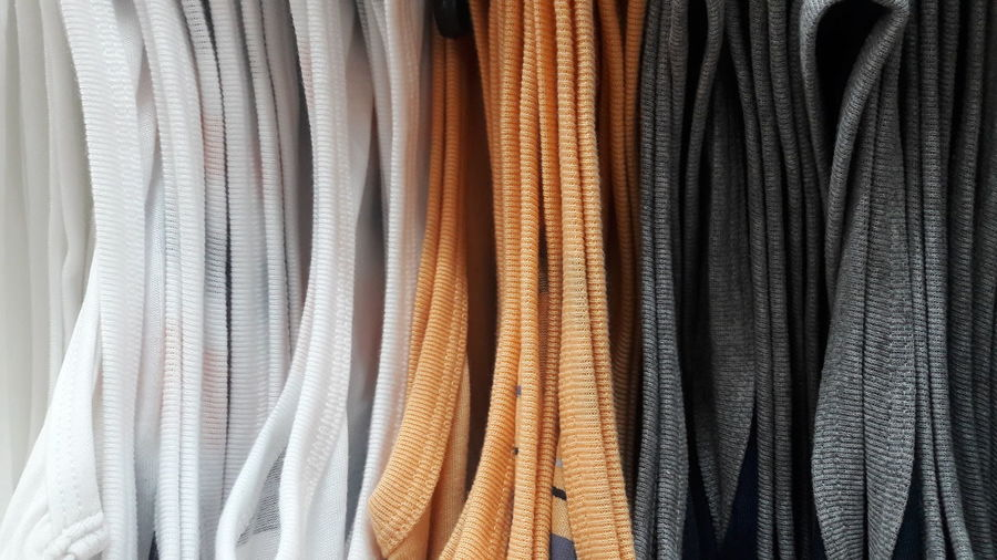Full frame shot of clothes hanging in store