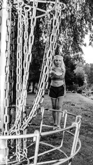Full Length One Person Lifestyles Leisure Activity Young Women Tree Outdoors Fashion Sports Training Sports Clothing Fitness Model California Beautiful Woman Escondido Tiina Kit Carson Park Female Model Escondido, Ca Only Women Blackandwhite Photography Exercising Fitness Black And White Disc Golf Disc Golf Basket Finding New Frontiers