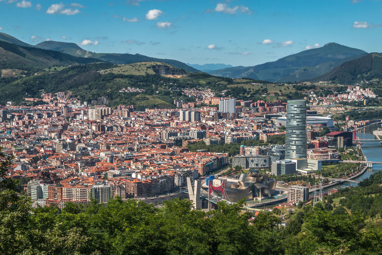 Panoramic view of Bilbao Spain Bilbao Basque Country Architecture Building Exterior Mountain Built Structure Building City Residential District Sky Tree Nature Mountain Range Plant Crowded Cityscape Town High Angle View House Day Outdoors Community TOWNSCAPE
