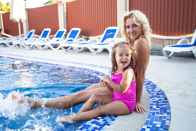 Portrait of a smiling girl in swimming pool