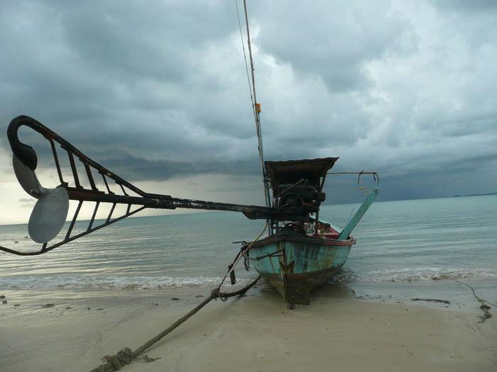 Lone Boat Moored On Calm Beach