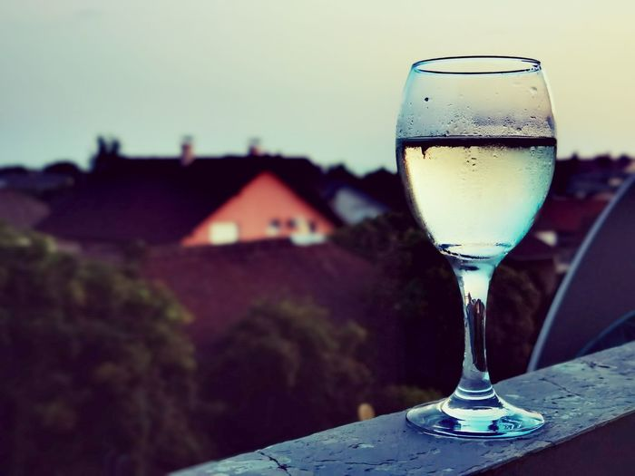 Close-up of beer glass against sky