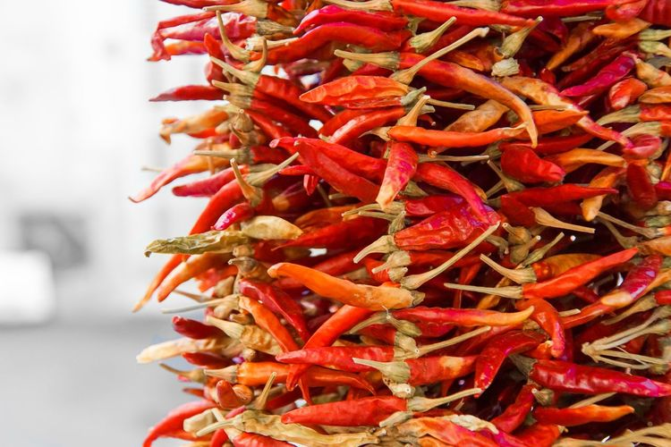 Close-Up Of Chili Peppers Hanging In Market
