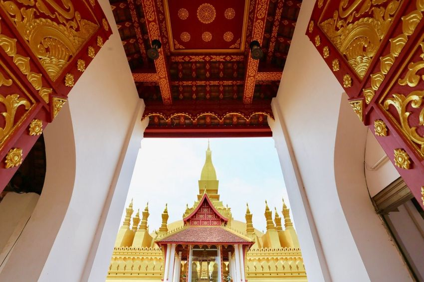 Laos, Vientiane, Pha That Luang Buddhism Stupa East Gate Architecture Built Structure Religion Building Belief Place Of Worship Spirituality Gold Colored