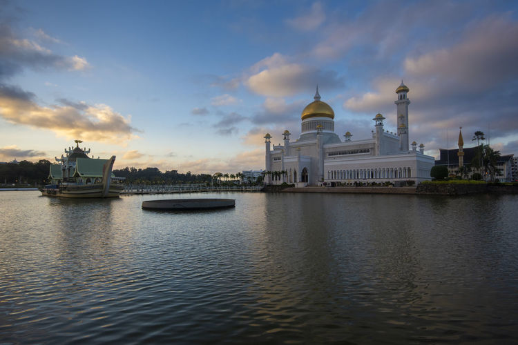 Sultan Omar Ali Saifuddin Mosque at Bandar Seri Begawan, Brunei Darussalam Sky Water Building Exterior Waterfront Architecture Built Structure Cloud - Sky Place Of Worship Religion No People Nature Spirituality Travel Travel Destinations Sunset Belief Building Sea Nautical Vessel Outdoors Government
