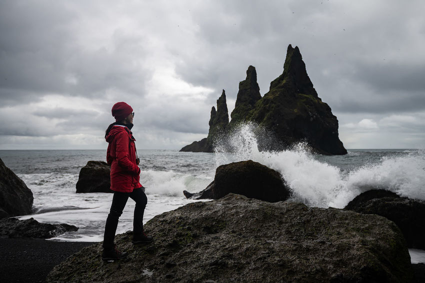 Basalt rock formations Troll toes on black Vik, Iceland Dramatic Sky Beach Beachphotography Beauty In Nature Black Cliff Cloud - Sky Motion Nature One Person Outdoors Power In Nature Reynisdrangar Rock Rock - Object Scenics - Nature Sea Sky Splashing Standing Toes Water