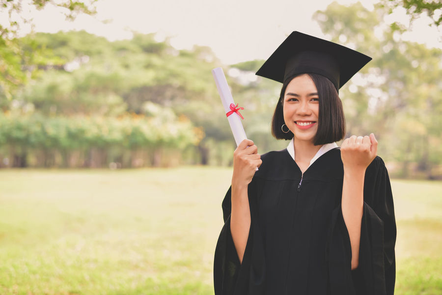 df9d0619c2 Achievement Beautiful Woman Certificate Education Focus On Foreground Graduation  Graduation Gown Happiness Holding Mortarboard One Person. Portrait of young  ...