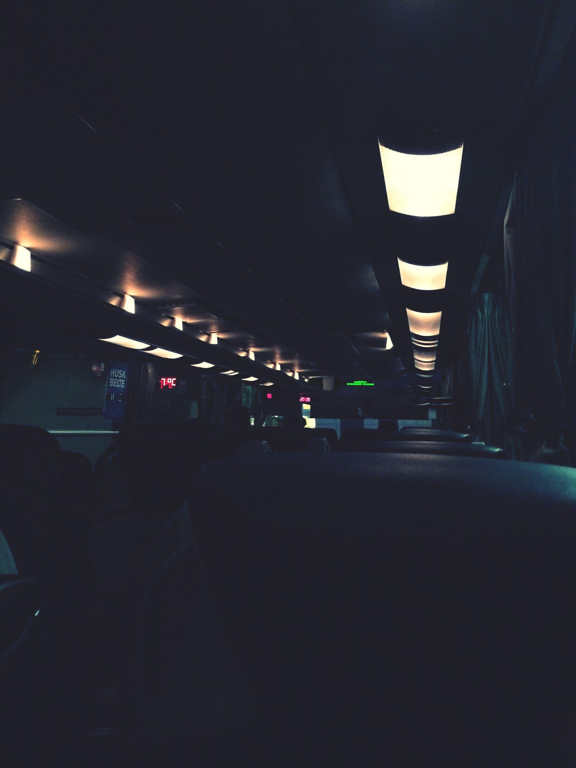 illuminated, night, transportation, lighting equipment, architecture, built structure, dark, indoors, mode of transport, the way forward, empty, street, absence, light - natural phenomenon, building exterior, street light, land vehicle, road, city, incidental people