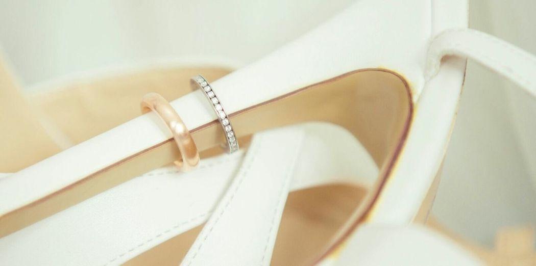 Close-up of wedding rings on stilettos