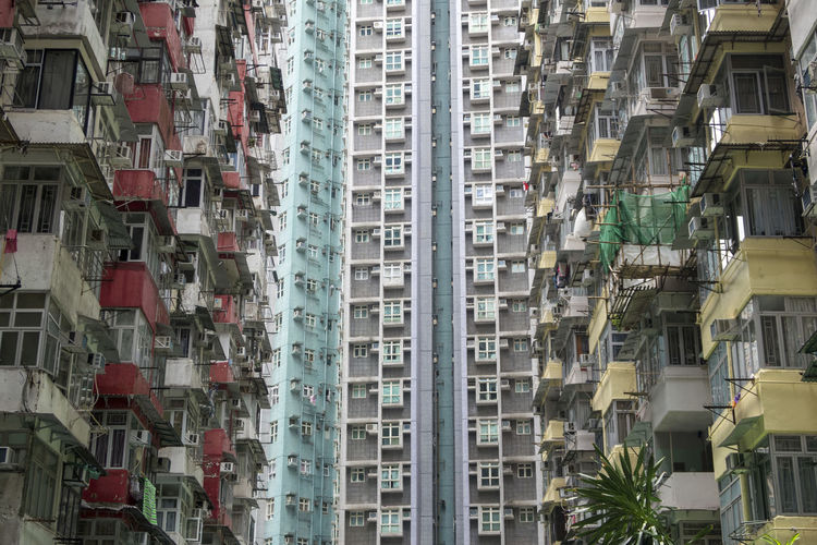 Hong Kong HongKong Air Conditioner Apartment Architecture Backgrounds Balcony Building Building Exterior Built Structure City City Life Day Full Frame In A Row Location Low Angle View Nature No People Outdoors Pattern Place Residential District Skyscraper Window