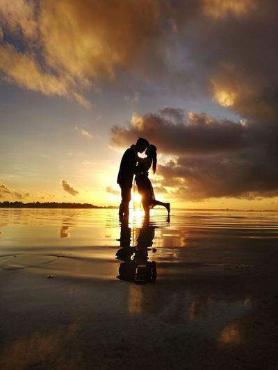 Love is when another person's happiness is equally as important as your own. kushandwisdom EyeEm Gallery EyeEm Eyeemphotography Huawei Photography Huaweinova2i Huaweimobile Sunrise Couple Prenup Orange Color Human Clouds And Sky Water Full Length Sea Men Beach Silhouette Standing Scuba Diving Reflection Low Tide Shore Horizon Over Water Calm Ocean