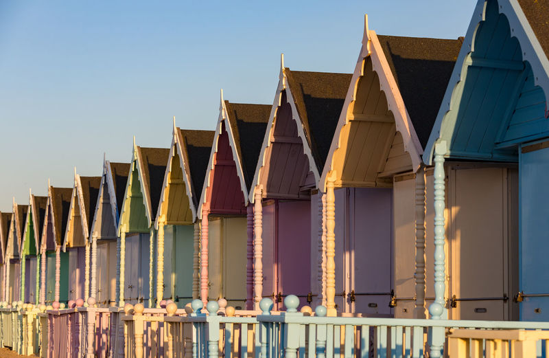 Colourful beach huts Wooden Painted EyeEm Selects EyeEm Gallery Seaside Seascape Pattern Beach Architecture Beach Hut Building Exterior Built Structure Clear Sky Colorful Day House Hut In A Row No People Outdoors Pastel Colors Roof Side By Side Sunny Day