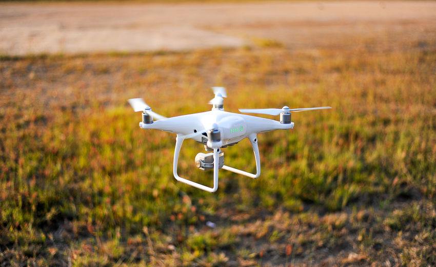 Aerospace Industry Air Vehicle Airplane Camera - Photographic Equipment Day Drone  Flying Focus On Foreground Mid-air Mode Of Transportation Motion Nature No People on the move Outdoors Plane Selective Focus Sunlight Surveillance Technology Transportation