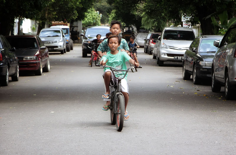Bicycle Transportation Full Length Adults Only Adult Mode Of Transport Car One Person Cycling Casual Clothing People Real People Outdoors Portrait One Woman Only Day Young Adult Yogjakarta INDONESIA Kids Happy People Happiness