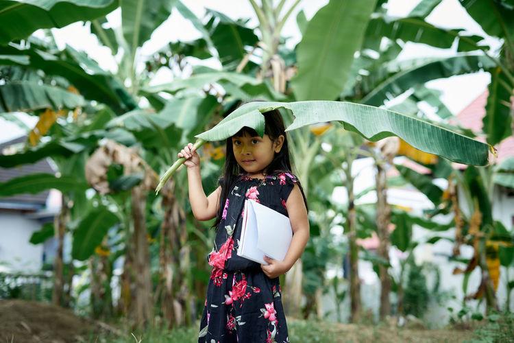 Full length of girl standing on leaves
