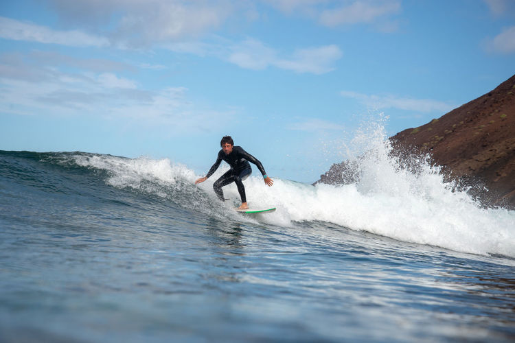 Water Sea Sport Motion Sky One Person Lifestyles Leisure Activity Wave Men Beauty In Nature Aquatic Sport Real People Adventure Waterfront Surfing Nature Splashing Skill  Power In Nature Outdoors
