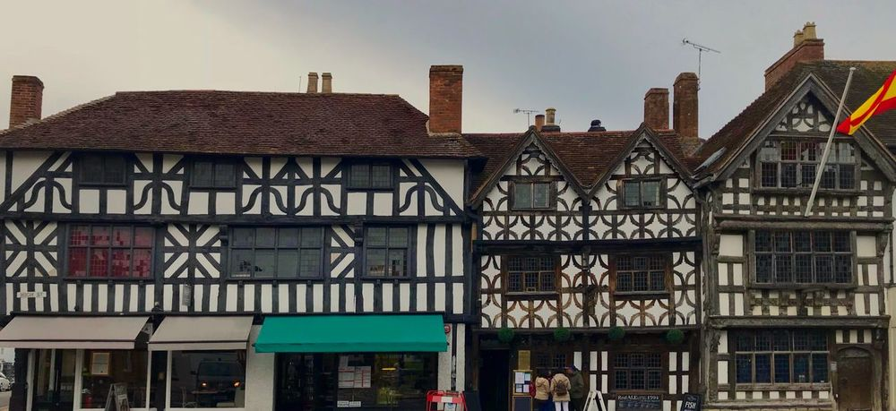 Tudor Architecture Architecture Building Exterior Built Structure Building Day No People City Sky Window History Low Angle View Residential District The Past Travel Destinations Nature Outdoors Clear Sky Old Text Tourism