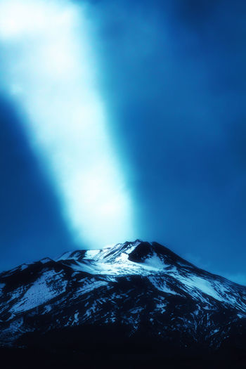 Etna Beam Of Light Beauty In Nature Blue Cloud - Sky Cold Temperature Environment Landscape Mountain Mountain Peak Mountain Range Nature No People Non-urban Scene Outdoors Ray Of Sun Scenics - Nature Sky Snow Snowcapped Mountain Tranquil Scene Tranquility Volcano Winter