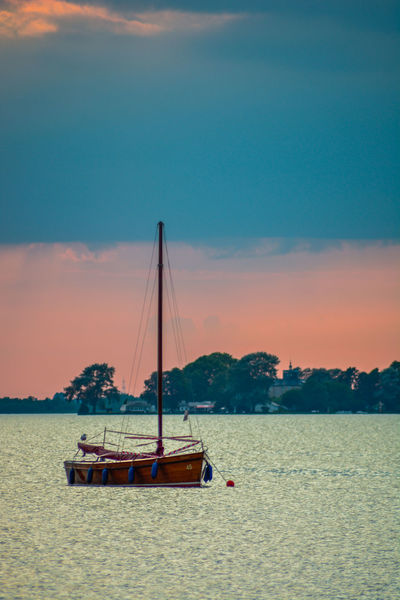 Nautical Vessel Sea Sunset Water Cloud - Sky Sky No People Scenics Outdoors Tranquility Sailboat Nature Transportation Beach Mast Horizon Over Water Travel Destinations Beauty In Nature Moored Day