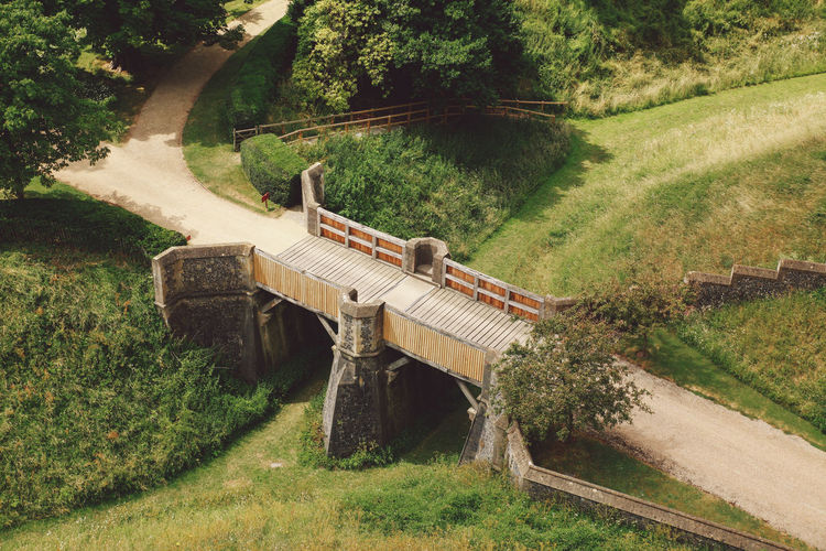 High angle view of footbridge over grassy field at arundel castle