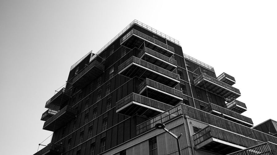 Urban Perspectives The Devil's In The Detail Black & White Monochrome Black And White Built Structure Architecture Low Angle View Building Exterior Sky Building Clear Sky No People Day Copy Space City Residential District Window Modern Tall - High Construction Industry Apartment Height Architectural Detail Balcony Architectural Feature