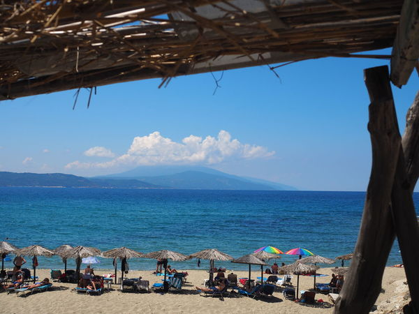 Beach Bar Beach Beauty In Nature Day Driftwood Holiday Horizon Horizon Over Water Land Mountain Nature Outdoors Parasol Sand Scenics - Nature Sea Shade Sky Tranquil Scene Tranquility Vacations Water