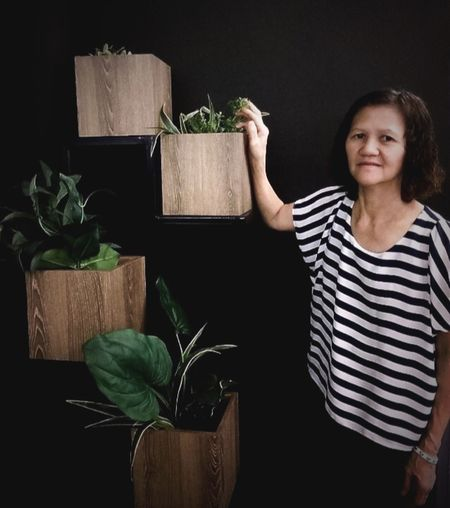 One Person Looking At Camera Portrait Indoors  Plant Potted Plant Striped Lifestyles Leaf Front View Casual Clothing Adult Real People Nature Plant Part Waist Up Black Background