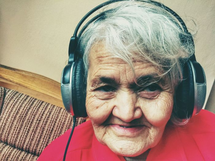 Portrait Of Old Woman Wearing Headphones