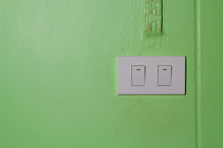 Close-up of green light on wall