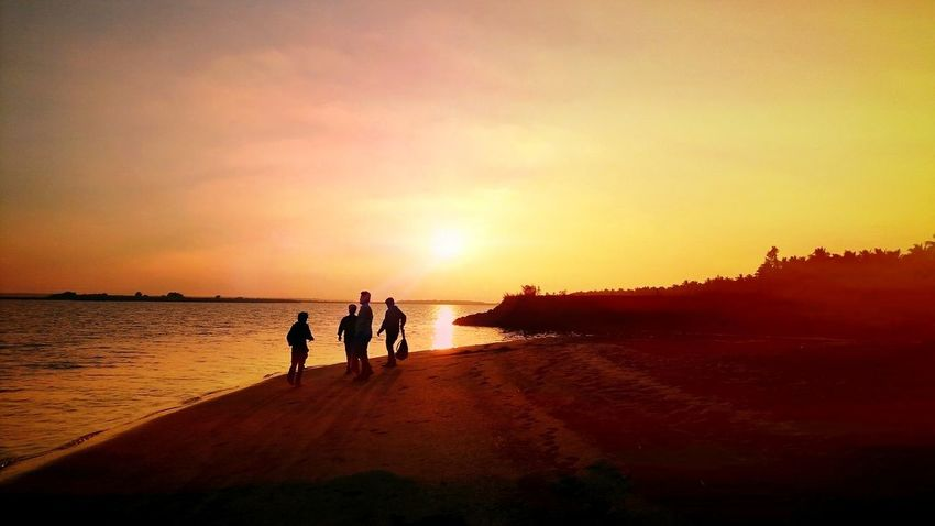 Beach Sunset Beach Sea Walking Two People Sand Outdoors Togetherness Water People Nature Sky Real People Adult Beauty In Nature Only Men Adults Only Day