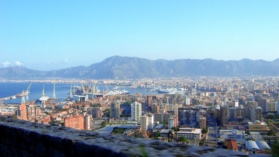 High angle view of buildings and mountains against clear sky