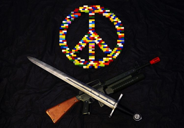 Black Background Break The Mold Close-up Death Of Peace EyeEm Gallery EyeEmNewHere Fight Indoors  Multi Colored No People Peace Peace Symbol Quiet Symbol Symbolism War Weapons
