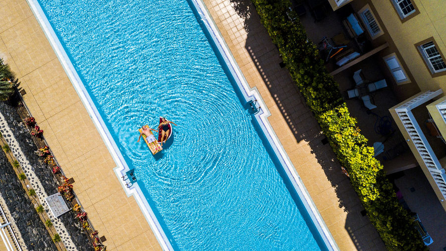 Aerial view of senior couple relaxing in swimming pool