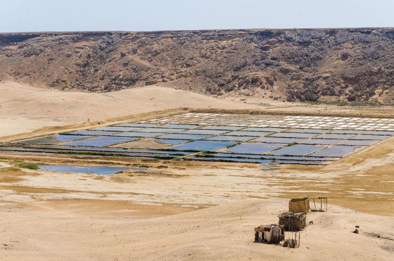 Scenic view salt mining against sky in mucuio, namib desert, angola