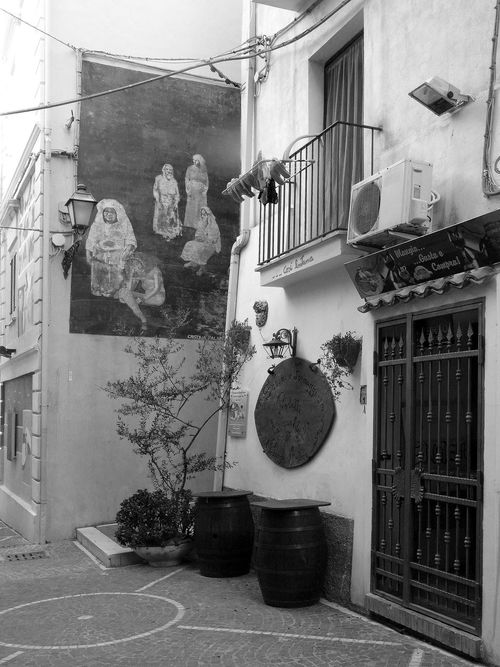 Glimpse of Diamante with murals Black & White Casks Diamante  Italia South Italy Architecture Balcony Black And White Black And White Photography Building Exterior Door Glimpse House Italy Mural Art Murales Outdoors Potted Plant Residential Building Street Travel Destination Window
