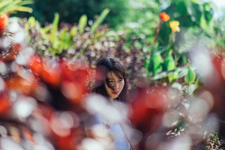 Selective Focus Plant Women One Person Young Adult Real People Day Young Women Adult Lifestyles Nature Portrait Plant Part Leisure Activity Leaf Front View Growth Outdoors Beautiful Woman Hairstyle