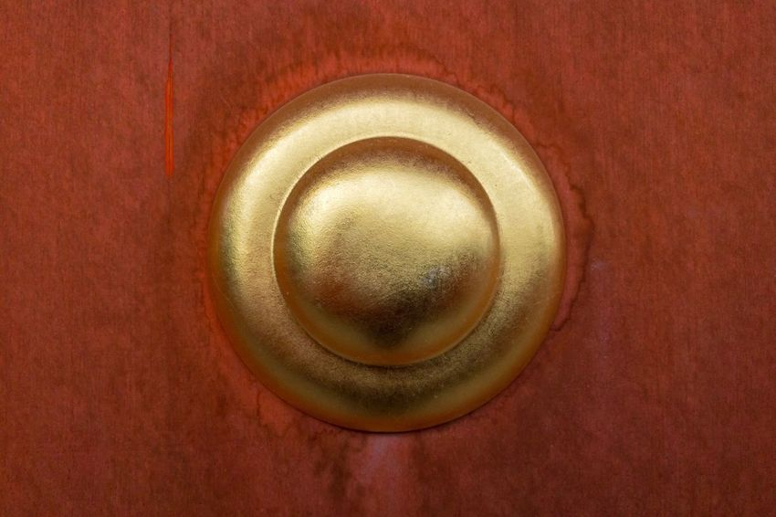Gold round on red door Centre Of Attention Shape Simple Abstract Minimalism Red Door Gold Colored Close-up No People Metal Single Object Indoors  Brown Full Frame Gold