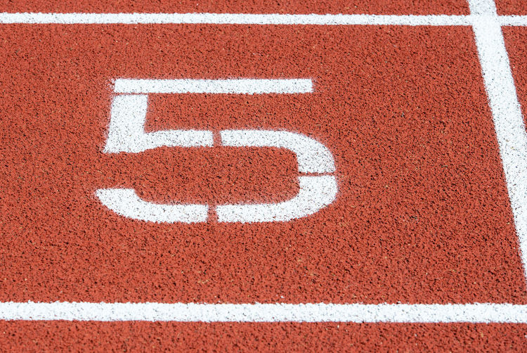 High angle view of number 5 on running track