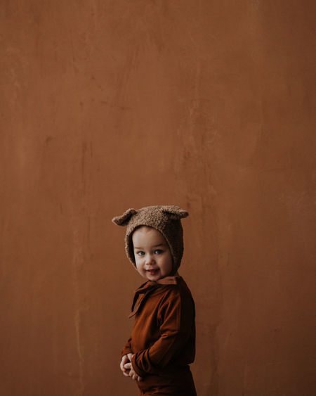 Toddler baby boy in funny costume with ears looking at the camera