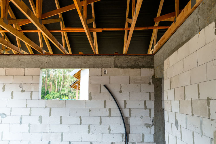 Roof trusses covered with a membrane on a detached house under construction, visible roof