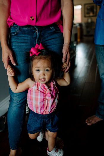 Cute baby girl with arms raised