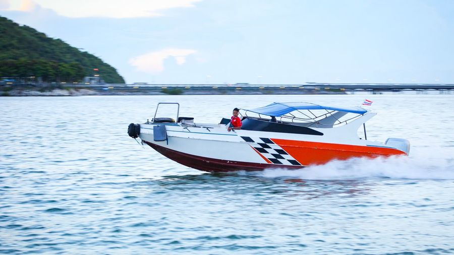 Speedboat On The Sea Outdoors Sea Nautical Vessel Transportation Water Mode Of Transport Nature Sky Day Cloud - Sky Beauty In Nature Scenics Men One Person Jet Boat People Investing In Quality Of Life