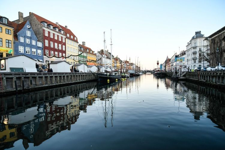 City Copenhagen, Denmark Copenhague Reflection Scandinavia Architecture Building Exterior Built Structure City Clear Sky Copenhagen Day Mode Of Transport Moored Nature Nautical Vessel No People Outdoors Reflection Residential Building Scanidinavia Sky Transportation Water Waterfront