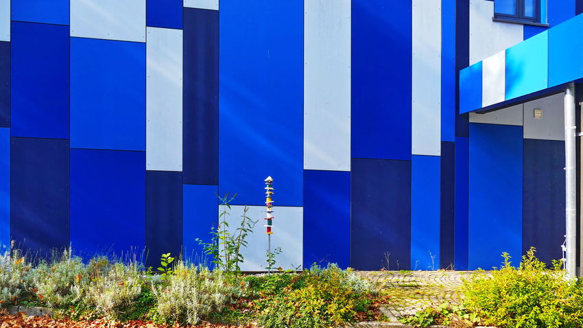 Paneling Architectural Column Architectural Design Architectural Detail Architecture Blue Building Exterior Built Structure Cladding Cladding Wall Day Fassaden Architektur Front View House Facades Multi Colored No People Outdoors Sheeting Striped Wall - Building Feature Wall Building Wall Cladding