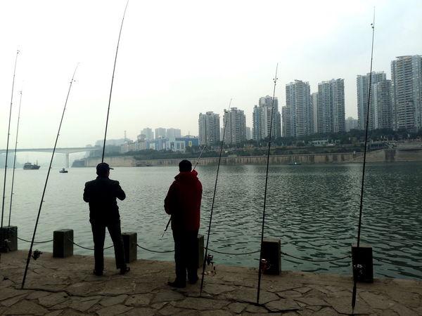 ASIA City City Life Fishing Man Urban Lifestyle China China Culture City Fishing Men People Real People Urban Urban Landscape Urbanphotography